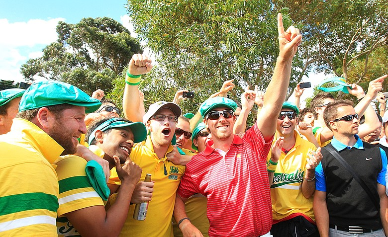 Hunter Mahan of the U.S. celebrates with Aussie fans on the 17th hole after the Day Four singles matches of the 2011 Presidents Cup.