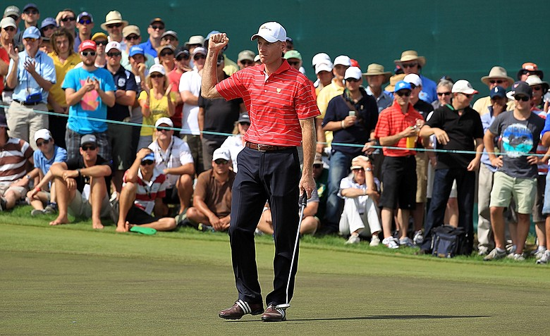 Jim Furyk of the U.S. celebrates making birdie to win the match on the 17th hole during the Day Two four-ball matches of the 2011 Presidents Cup.