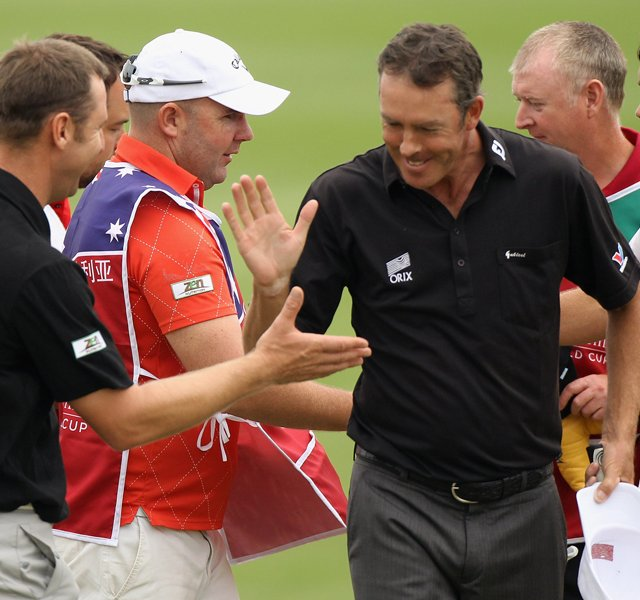 Richard Green and playing partner Brendan Jones of Australia celebrate on the 18th green during the first-day fourballs at the Omega Mission Hills World Cup.