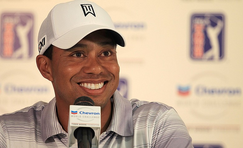 Tiger Woods speaks with the media after the pro-am prior to the start of the Chevron World Challenge.
