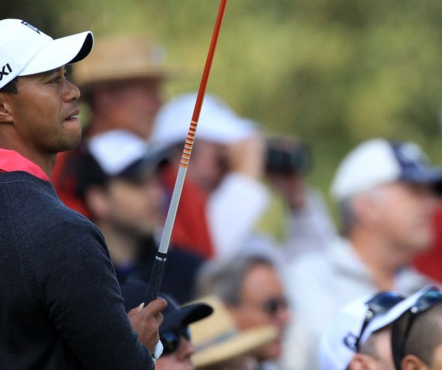 Tiger Woods watches his tee shot on the second hole during the first round of the Chevron World Challenge at Sherwood Country Club.