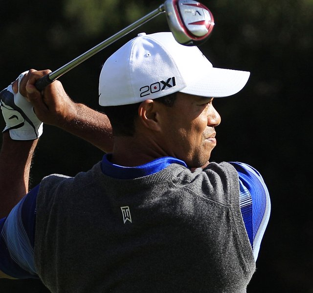 Tiger Woods watches his third shot on the fifth hole during the second round of the Chevron World Challenge.