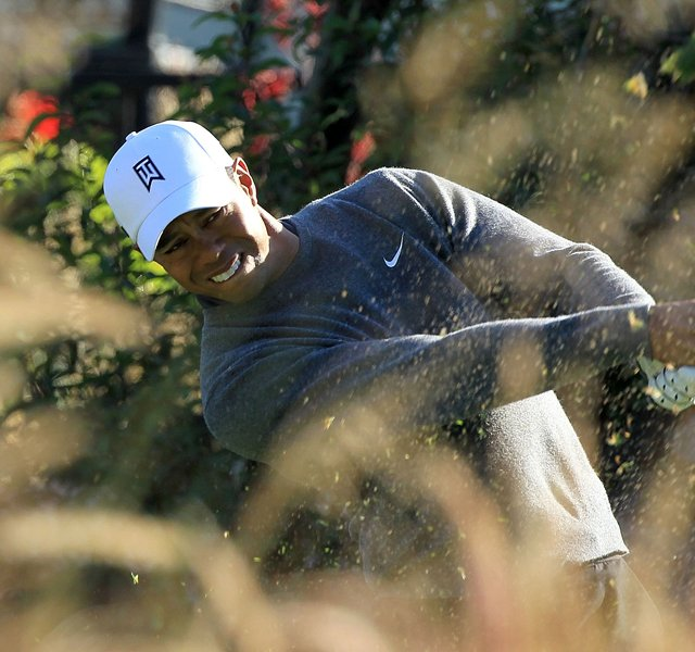 Tiger Woods hits his tee shot on the 12th hole during the third round of the Chevron World Challenge.