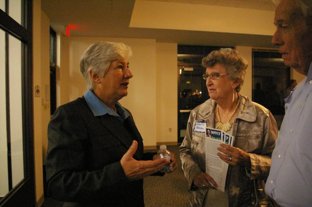 Winter Park mayoral candidate Nancy Miles talks with supporters at her campaign kickoff party Dec. 5.