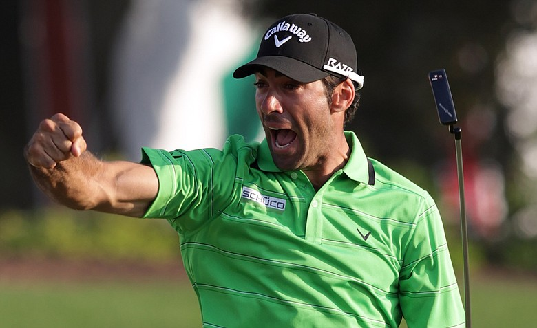 Alvaro Quiros of Spain celebrates on the 18th green after the final round of the Dubai World Championship.