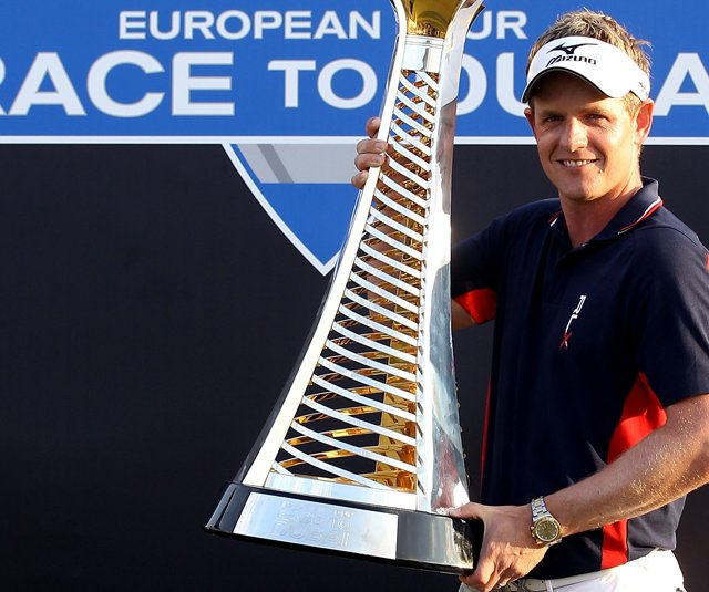 Luke Donald poses with the trophy after winning The Race To Dubai at the Dubai.