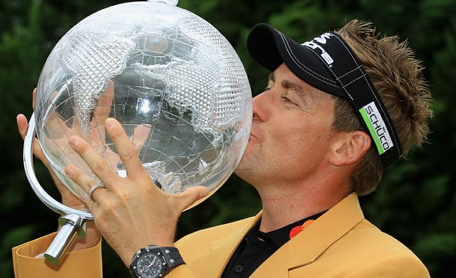 Ian Poulter celebrates his victory with the trophy and gold jacket after the final round of the 2011 Australian Masters.