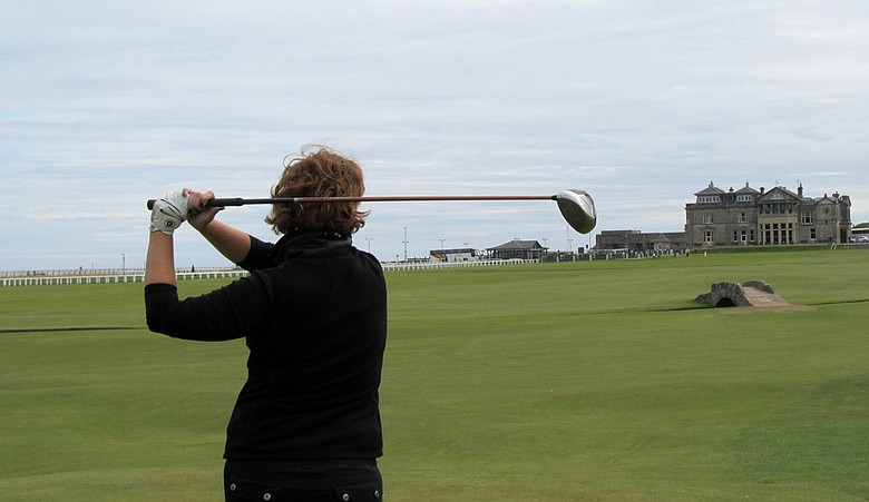 Beth Ann holds her finish on the 18th tee at the Old Course.