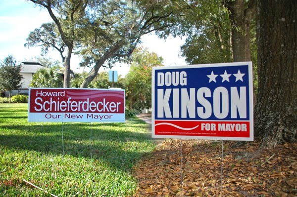 Schieferdecker and Kinson campaign signs dot city lawns. Yanchunis signs will go out this week. (Photo illustration)