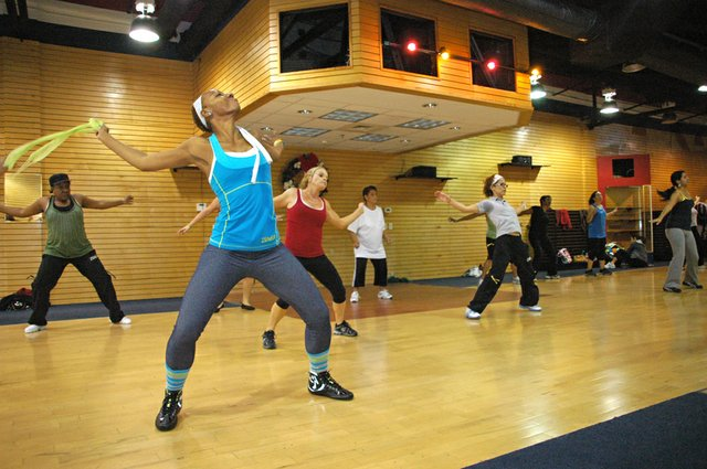 House of Da'Le co-owner Annette Escoffery dances with the class during a Zumba session at their new location in the Oviedo Mall.