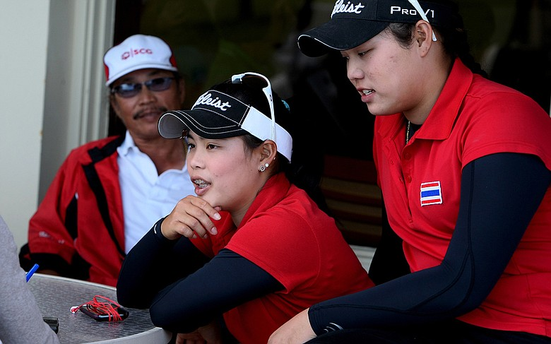 Moriya (center) and Ariya Jutanugarn (right), with their father, Somboon, in the background, following the second round of the 2012 South Atlantic Amateur.