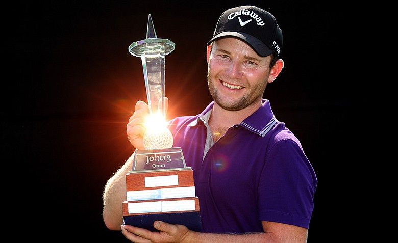 Branden Grace of South Africa poses with the trophy after winning the Joburg Open at Royal Johannesburg and Kensington Golf Club on January 15, 2012 in Johannesburg, South Africa.