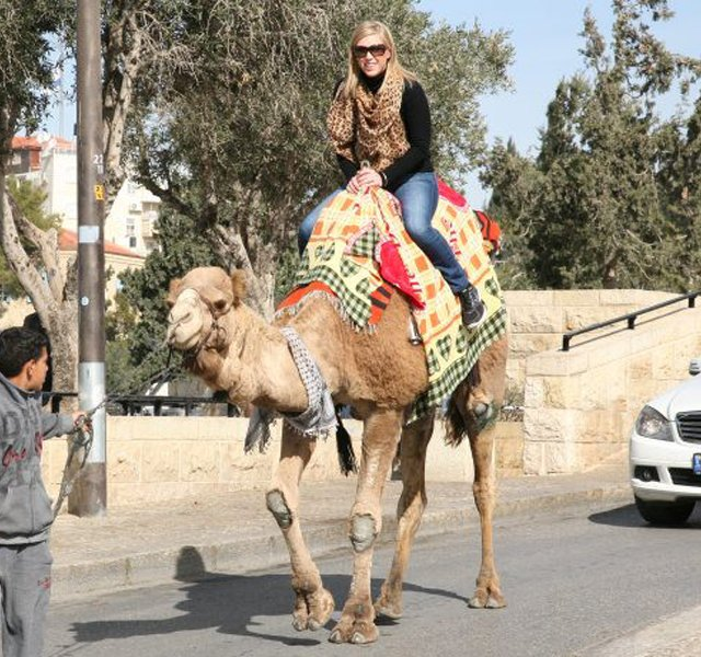 Morgan Pressel on a camel ride.