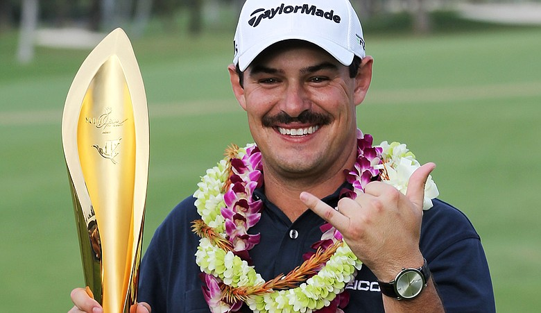Johnson Wagner holds the trophy after winning the Sony Open in Hawaii at Waialae Country Club.
