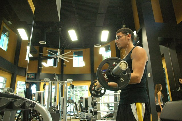 Orlando Cintron, 18, lifts weights at the newly opened Zoo Health Club in Winter Springs.