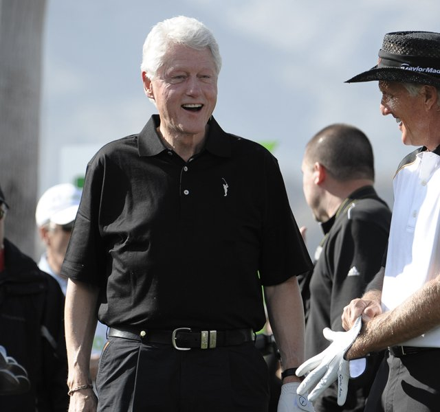 Former President Bill Clinton (left) chats with Greg Norman prior to teeing off on the Palmer Private Course at PGA West