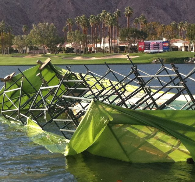 Strong winds blew a hospitality tent into the water during the third round of the Humana Challenge.