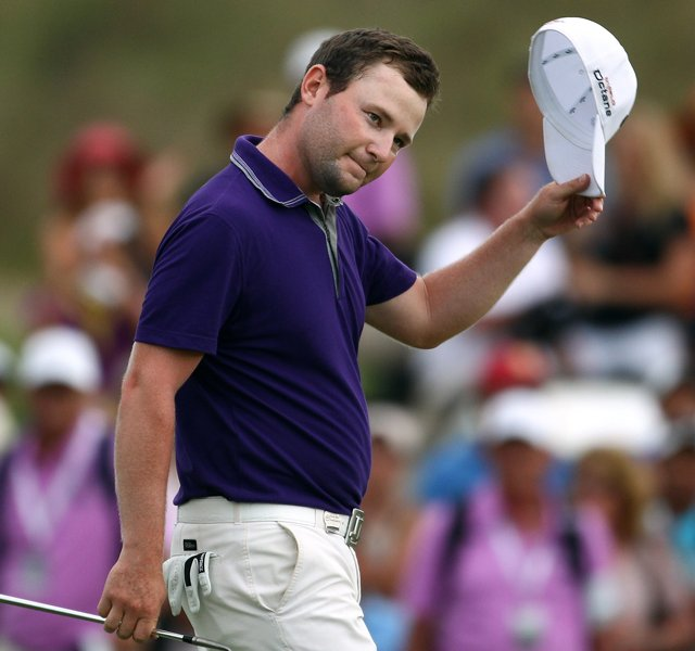 Branden Grace of South Africa won the Volvo Golf Champions at The Links at Fancourt in a one-hole playoff with Ernie Els and Retief Goosen.