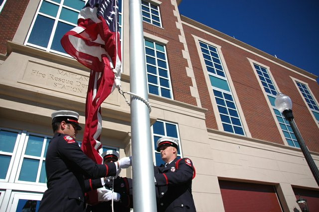 Firefighters raise the American flag for the first time in front of the new Maitland Fire Station No. 45, which was dedicated Jan. 19.