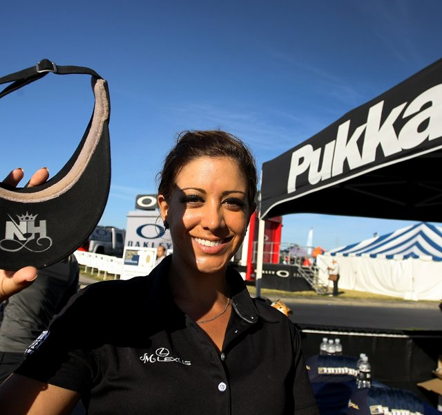 LPGA player Nicole Hage shows the underside of her Pukka visor early on Demo Day. Every Pukka player has a unique logo featuring his or her initials.