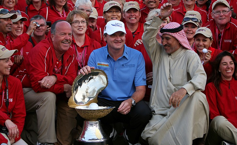 Paul Lawrie poses with his trophy after winning the Qatar Masters at the Doha Golf Club.