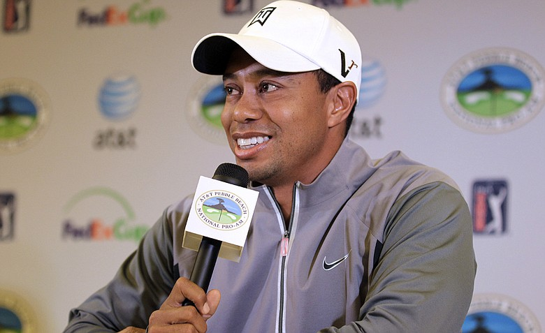Tiger Woods talks to reporters during a news conference at the AT&T Pebble Beach National Pro-Am golf tournament in Pebble Beach.