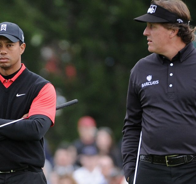 Tiger Woods was 2 over through the first nine holes, while Phil Mickelson was 5 under on the front nine.