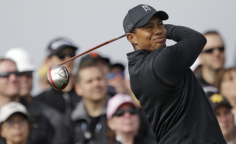 Tiger Woods fired a 5-under 67 on Saturday and is four shots behind Charlie Wi heading into the final round.