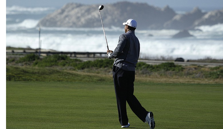 Tiger Woods hits during a practice round at the AT&T Pebble Beach National Pro-Am.
