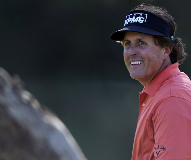 Phil Mickelson smiles after his birdie on the seventh hole during the first round of the Northern Trust Open.