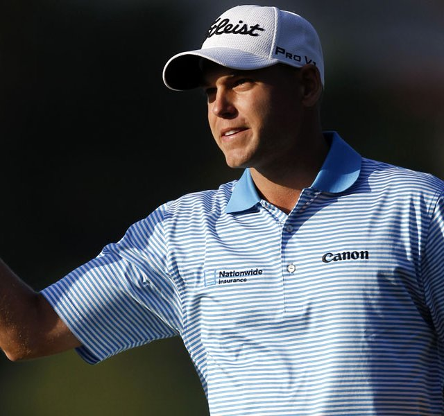 Bill Haas celebrates after winning the Northern Trust Open golf tournament on the second playoff hole at Riviera Country Club.