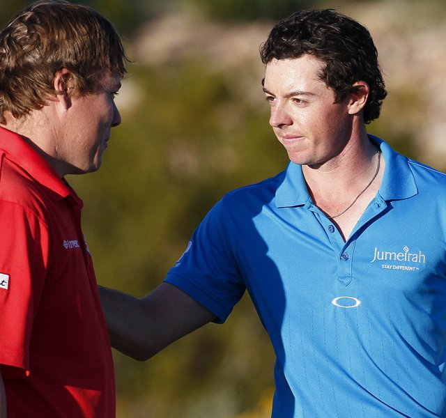 Rory McIlroy, right, greets George Coetzee after McIlroy won their first-round match, 2 up.