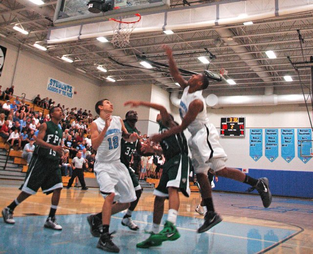 Cartree Pettis launches toward the basket during the Huskies' blowout win over Flagler Palm Coast Feb. 16.