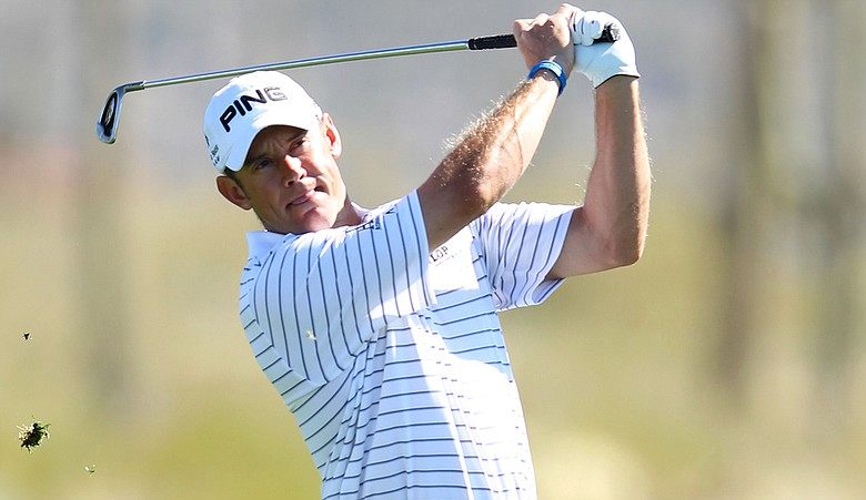Lee Westwood hits an approach shot on the second hole during the third round of the WGC-Accenture Match Play Championship.