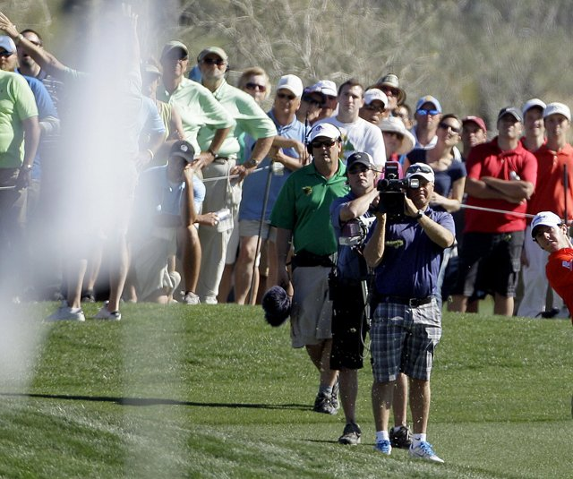 Rory McIlroy hits a shot onto the 14th green while playing Sang-moon Bae during the WGC-Match Play Championship.