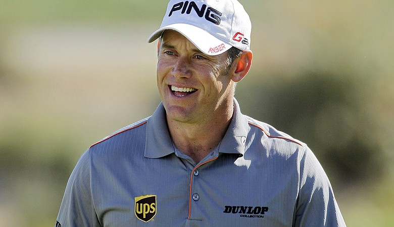 Lee Westwood smiles after chipping onto the 16th green while playing Martin Laird during the WGC-Match Play Championship.