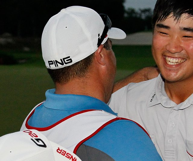 John Huh celebrates with his caddie Zeke Salas after winning the Mayakoba Golf Classic.