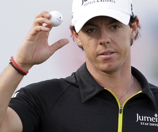 Rory McIlroy reacts on the 18th hole after finishing the third round of Dubai Desert Classic.