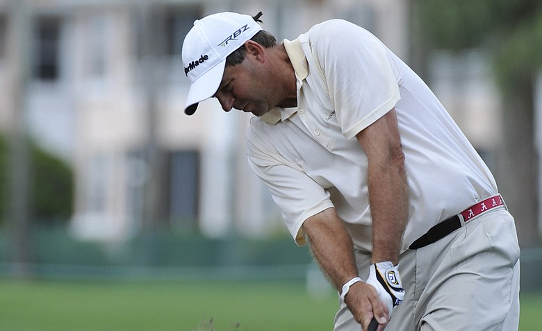 Dicky Pride hits from the rough on the eighth hole during the first round of the Honda Classic.