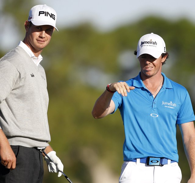 Rory McIlroy of Northern Ireland, right, talks with Harris English, left, during the final round of the Honda Classic.