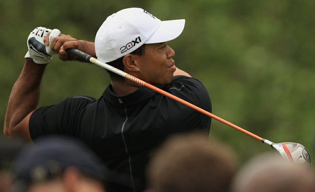 Tiger Woods watches a shot on the third hole during first round of the World Golf Championships-Cadillac Championship on the TPC Blue Monster at Doral.