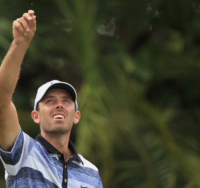 Charl Schwartzel tests the wind on the 15th hole during first round of the WGC-Cadillac Championship.