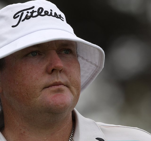 Australia&#39;s Jarrod Lyle watches his ball on the 18th hole during the first round of the Australian Open.