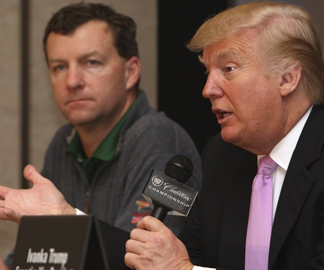 Donald Trump, right, speaks during a Thursday news conference at the Cadillac Championship, as golf course designer Gil Hanse looks on. Trump purchased the Doral Hotel & Country Club, which includes four championship golf courses.