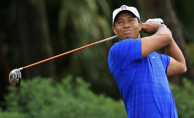 Tiger Woods watches his tee shot on the 12th hole during the second round of the WGC-Cadillac Championship at Doral.