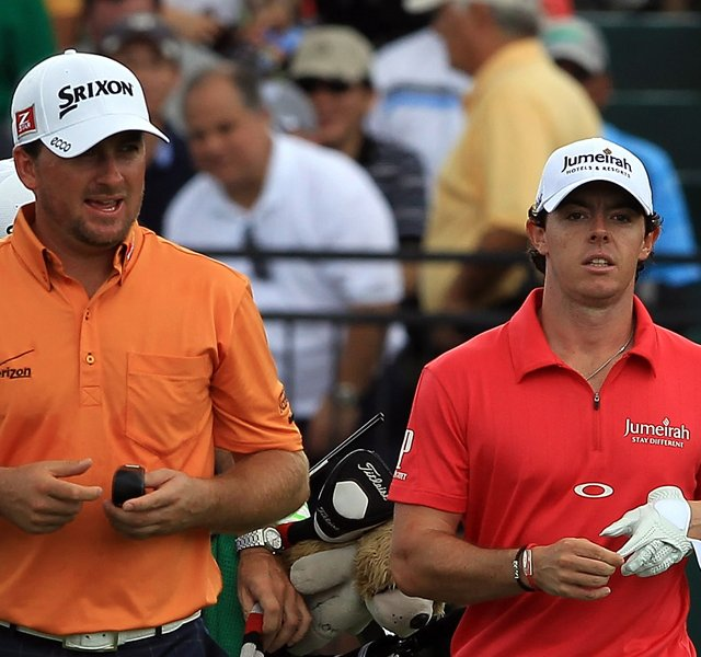 Rory McIlroy and his playing partner Graeme McDowell leave the first tee during the third round of the WGC-Cadillac Championship.
