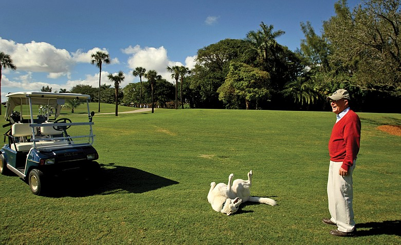 Pete Dye and his German shepherd Sixty at Gulf Stream Golf Club in Delray Beach, Fla.