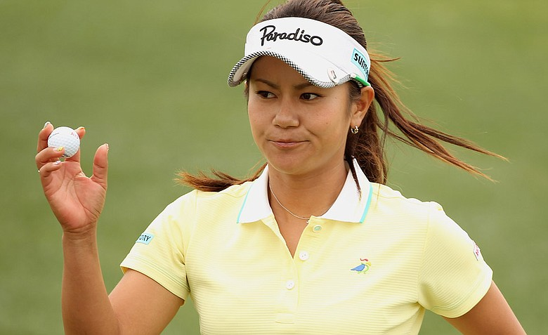 Ai Miyazato celebrates a birdie putt on the 11th hole during the third round of the RR Donnelley LPGA Founders Cup.