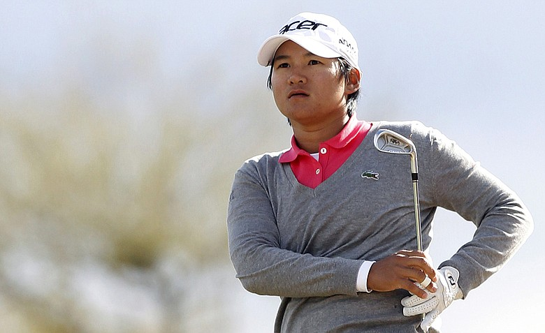 Yani Tseng watches her approach shot land on the 11th green during the final round of the LPGA Founders Cup.