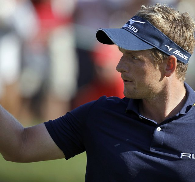 Luke Donald, of England, holds up his golf ball after saving par on the 17th hole during the final round of the Transitions golf tournament.